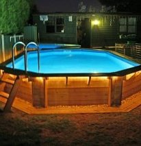 backyard swimming pool above ground lighted