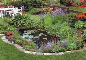 garden design with pond and colorful flower beds
