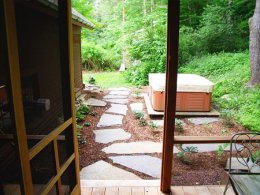 When the perennials grow in it will be a beautiful transition from the forest to the landscaped area.